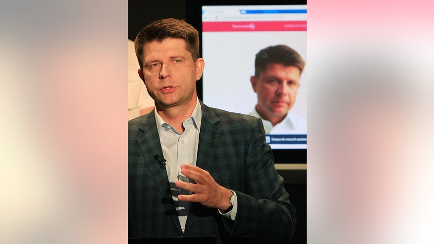 The leader of Poland's new political movement, ModernPL Association, economist Ryszard Petru  talks about the transparent way of financing that his movement is seeking, via online donations from supporters at a news conference in Warsaw, Poland on Friday, June 26, 2015. (AP Photo/Czarek Sokolowski)