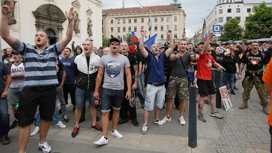 Protesters shout slogans during a far right demonstration in Brno, Czech Republic, Friday, June 26, 2015. Hundreds of far right protesters rallied against immigrants and Islam in the second largest Czech city of Brno while others gathered nearby in support of immigration. (AP Photo/Petr David Josek)