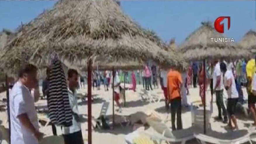 In this screen grab taken from video provided by Tunisia TV1, injured people are treated on a Tunisian beach Friday June 26, 2015. Two gunmen rushed from the beach into a hotel in the Tunisian resort town of Sousse Friday, killing at least 27 people and wounding six others in the latest attack on the North African country's key tourism industry, the Interior Ministry said. (Tunisia TV1 via AP) MANDATORY CREDIT