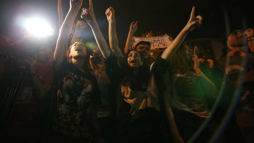 Armenian protesters shout anti-government slogans during a protest rally against a hike in electricity prices in Yerevan, Armenia, Thursday, June 25, 2015. Armenia's premier has rejected demonstrators' demand to annul a hike in electricity prices, a stance that signals no end in sight for the worst unrest the ex-Soviet nation has seen in years. (Hrant Khachatryan/PAN Photo via AP)