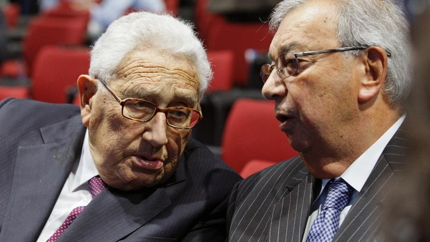 FILE - In this June  21, 2012 file photo, former Russian Prime Minister Yevgeny Primakov, right, and former U.S. Secretary of State Henry Kissinger speak as they take part in an economic forum in St. Petersburg, Russia. Primakov, whose career included journalism, diplomacy and spycraft, has died at age 85. The Kremlin said Friday, June 26, 2015 that President Vladimir Putin has offered condolences to Primakov's family. The cause of death wasn't immediately known. (AP Photo/Dmitry Lovetsky, File)