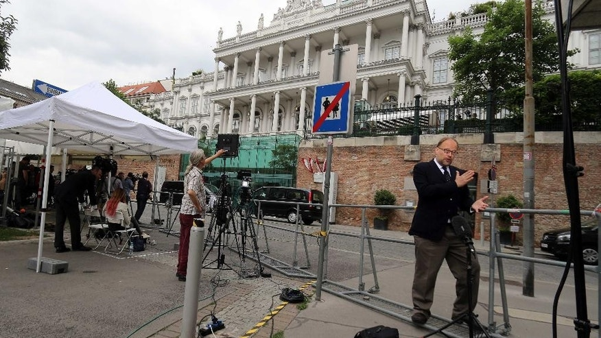 Journalists are waiting in front of Palais Coburg where closed-door nuclear talks with Iran take place in Vienna, Austria, Saturday, June 27, 2015. (AP Photo/Ronald Zak)