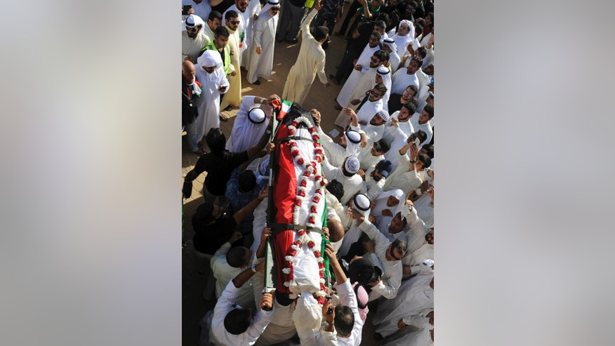Thousands of Sunnis and Shiites from across the country take part in a mass funeral procession for 27 people killed in a suicide bombing that targeted the Shiite Imam Sadiq Mosque a day earlier, at Kuwait's Grand Mosque in Kuwait city, Kuwait, Saturday, June 27, 2015. Police in Kuwait said they are interrogating a number of suspects with possible links to the suicide bombing, which was claimed by an affiliate of the Islamic State group. (AP Photo)