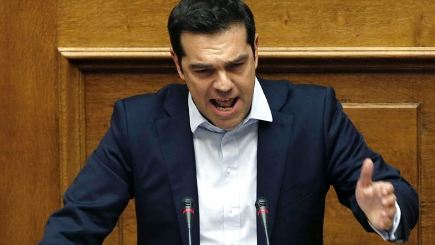 June 27, 2015: Greece's Prime Minister Alexis Tsipras delivers a speech to the lawmakers during an emergency Parliament session for the governments proposed referendum in Athens, Saturday. (AP)
