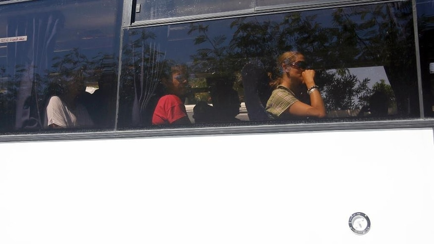 Tourists leaving from attacked Imperial Marhaba hotel in Sousse, Tunisia, Saturday, June 27, 2015. The morning after a lone gunman killed tens of people at a beach resort in Tunisia, busloads of tourists are heading to the nearby Enfidha-Hammamet airport hoping to return to their home countries. (AP Photo/Darko Vojinovic)