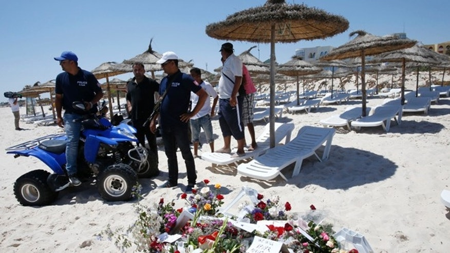 June 28, 2015: Police officers guard the scene of the attack in Sousse, Tunisia.
