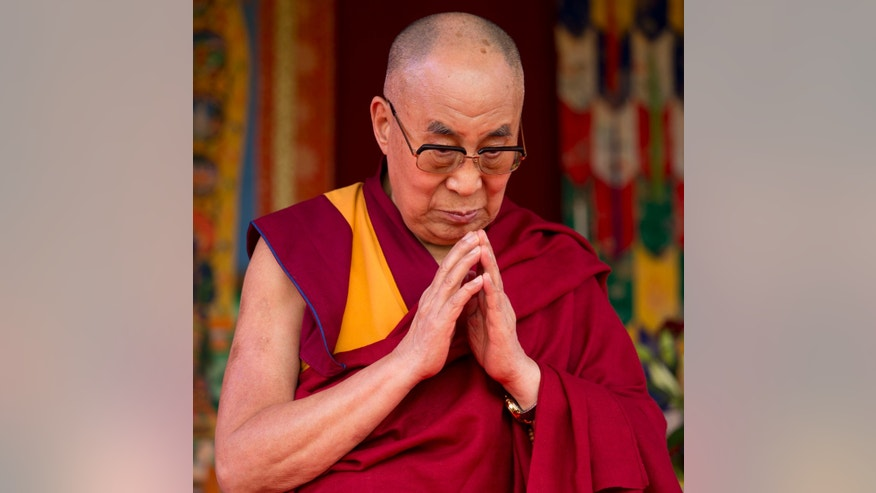 Monday, June 29, 2015: Tibet's exiled government and Buddhist spiritual leader the Dalai Lama stands on stage before making a speech to an audience at the ESS Stadium in Aldershot, southern England.