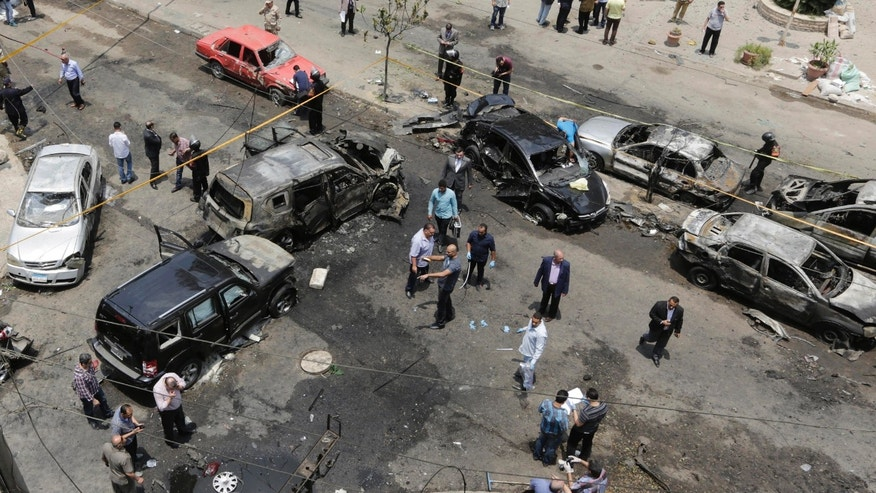 June 29, 2015 - Security personnel inspect damage after a bomb attack that targeted Egypt's prosecutor general in the Heliopolis district of Cairo. An official says the attack targeted Hisham Barakat's convoy, killing him and wounding others.