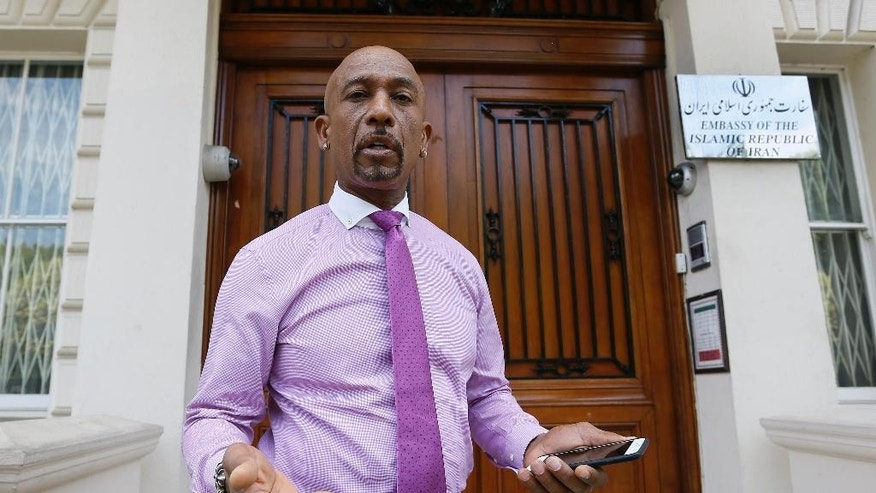 FILE - In a Friday, June 26, 2015 file photo, American television personality Montel Williams speaks to media outside the Iranian Embassy in London. Williams went to the embassy to request a meeting with the Iranian Chief of Mission. Williams is campaigning for the release of Amir Hekmati, an American who is being held in Iran's Evin Prison. (AP Photo/Kirsty Wigglesworth, File)