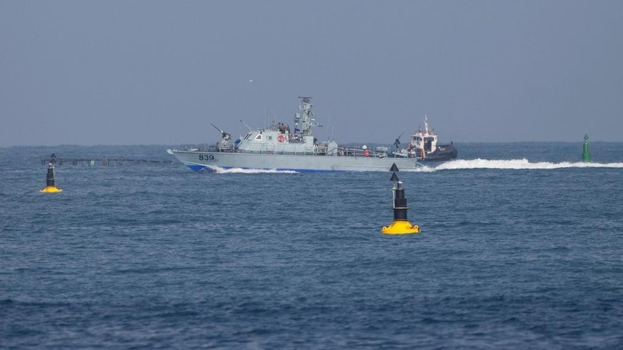 An Israeli naval battle ship sails in Mediterranean sea back to Ashdod port in Israel, Monday, June 29, 2015. Israel's navy intercepted a vessel attempting to breach a naval blockade of Gaza early Monday and was redirecting it to an Israeli port, the military and the activists said. (AP Photo/Ariel Schalit)