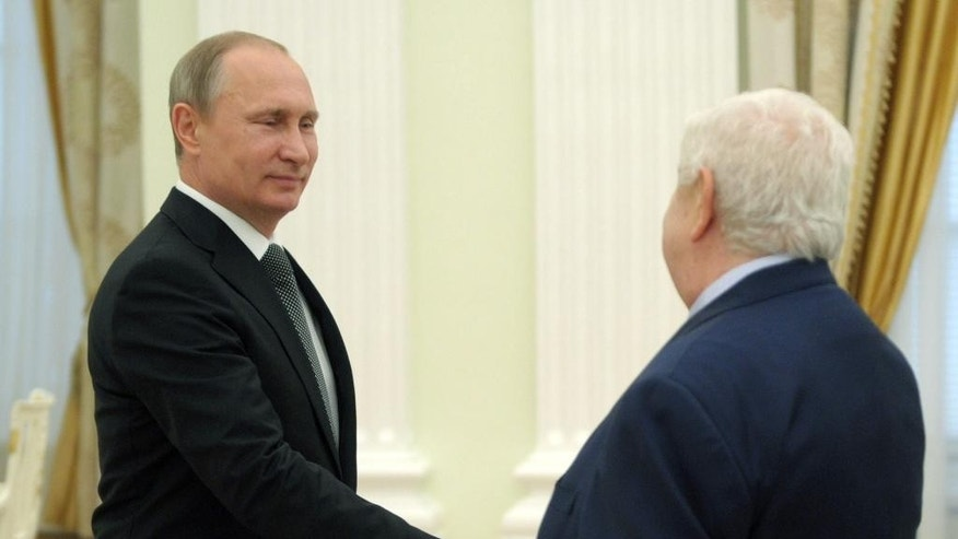 Syrian Foreign Minister Walid al-Mualem, right, meets with Russian President Vladimir Putin in Moscow's Kremlin, Russia on Monday, June 29, 2015. (Alexei Nikolsky/RIA Novosti, Kremlin Pool Photo via AP)