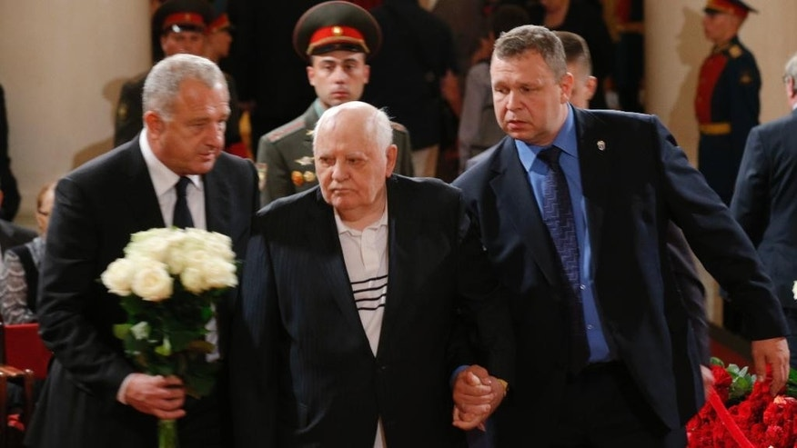 Former Soviet President Mikhail Gorbachev, center, walks after he paid last respect during a civil funeral of former Russian Prime Minister Yevgeny Primakov, in Moscow's House of Unions, Russia, Monday, June 29, 2015. Primakov, whose career included journalism, diplomacy and spycraft, died at age 85. The Kremlin said Friday that President Vladimir Putin offered condolences to Primakov's family. (AP Photo/Alexander Zemlianichenko)