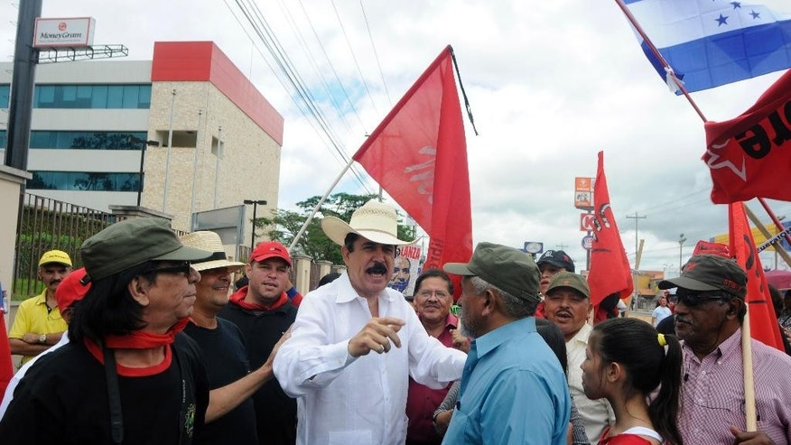 Former Honduras President  Juan Manuel Zelaya, marches with members of the National Front for Popular Resistance (FNRP) to protest against recent government corruption scandals and also to mark the 6th anniversary of the 2008 military overthrow of  Zelaya in Tegucigalpa, Honduras, Sunday, June 28, 2015. The current government has been under pressure over a corruption scandal that involved the alleged embezzlement of as much as $120 million from the Central American country's Social Security Institute. (AP Photo/Fernando Antonio)