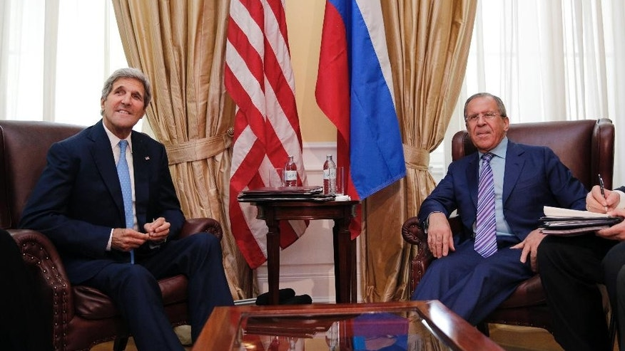 U.S. Secretary of State John Kerry, left,  meets with Russian Foreign Minister Sergey Lavrov at a hotel in Vienna Tuesday June 30, 2015. Talks continued in Vienna Tuesday on Iran's nuclear programme. (Carlos Barria/Pool, via AP)