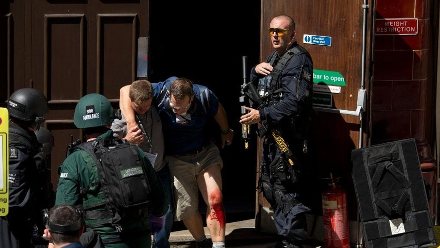 During a training exercise for London's emergency services, a casualty is helped to leave the disused Aldwych underground train station in London, Tuesday, June 30, 2015. Hundreds of British police are taking part in a major counter-terror exercise in London, testing the abilities of emergency services to respond to a Tunisia-style attack of extremists with firearms. The exercise dubbed Operation Strong Tower has been planned for six months and is not connected to the recent attack at a north African beach resort.  (AP Photo/Matt Dunham)