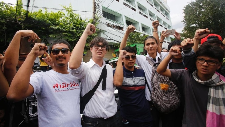 In this June 24, 2015 photo, student activists gather outside Pathumwan Police Station in Bangkok, Thailand. The U.N. human rights office has called on Thailand to release the 14 student activists arrested for holding a peaceful rally and charged with sedition. The 14 arrested on Friday were also charged with violating the junta's ban on political gatherings for taking part in an anti-coup rally in Bangkok. (AP Photo/Sakchai Lalit)