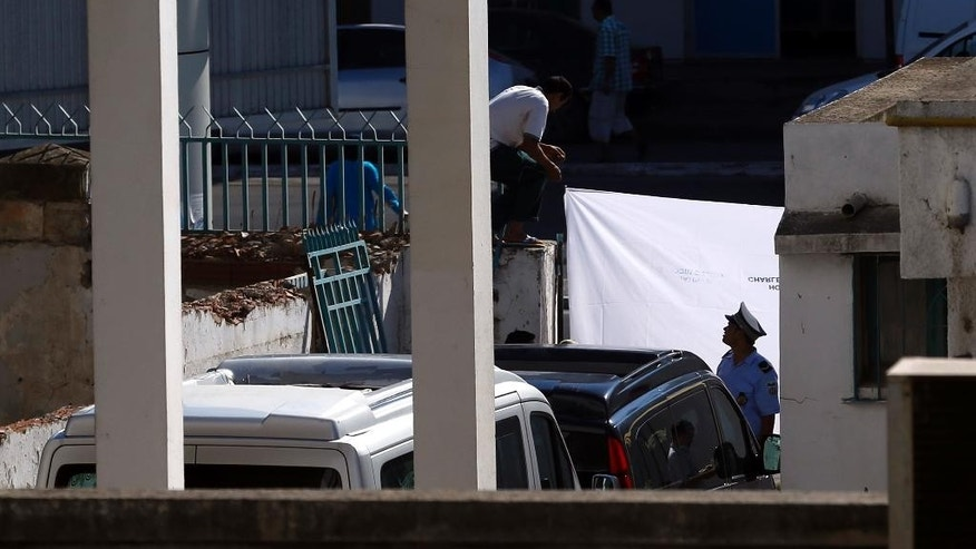Hearses prepare to leave the Tunis morgue Wednesday, July 1, 2015 in Tunis, Tunisia. Britain has begun repatriating the remains of victims of last week's terror attack at a beach resort in Tunisia. Some 24 Britons are confirmed to have died in the attack in the north African resort of Sousse, but the number is expected to rise. (AP Photo/Darko Vojinovic)