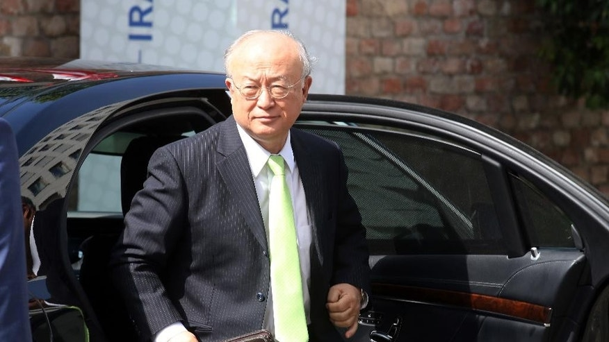 Director General of the International Atomic Energy Agency, IAEA, Yukiya Amano of Japan arrives at the Palais Coburg where closed-door nuclear talks with Iran take place in Vienna, Austria, Tuesday, June 30, 2015. Talks continued Tuesday on Iran's nuclear program. (AP Photo/Ronald Zak)
