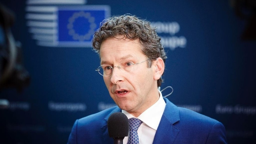 "Dutch Finance Minister and chair of the eurogroup Jeroen Dijsselbloem speaks to reporters in the Dutch parliament after a teleconference of the 19 eurozone finance ministers in The Hague, Netherlands on Tuesday, June 30, 2015. Dijsselbloem, says ""it would be crazy to extend"" the Greek bailout beyond its midnight expiration since Greece won't accept the European proposals on the table. He said that a Greek request for a new European aid program would be considered later. (AP Photo/Phil Nijhuis)"