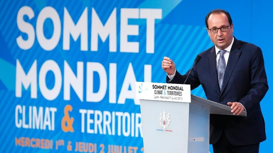 French president Francois Hollande delivers a speech during the Climate & Territories World Summit in Lyon, central France, Wednesday, July 1 2015. Hundreds of mayors, CEOs and trade groups from around the world are submitting their ideas for reducing global warming to the French government as it prepares to host a major U.N. climate conference later this year. (Ian Langsdon, pool via AP)