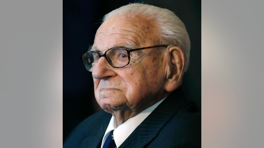 Tuesday, Oct. 28, 2014: A photo from files of the then 105 year-old Sir Nicholas Winton waiting to be decorated with the highest Czech Republic's decoration, The Order of the White Lion at the Prague Castle in Prague, Czech Republic.