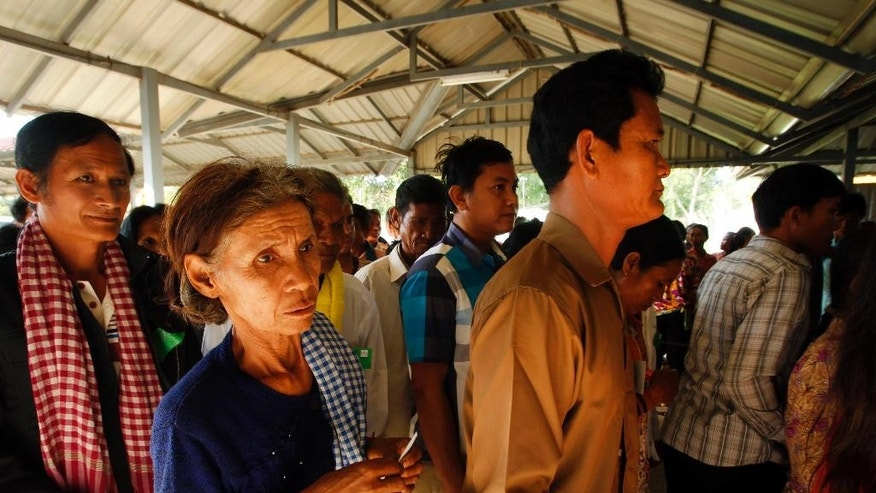 Cambodian villagers wait to enter a courtroom before the first appeal hearings against two former Khmer Rouge senior leaders, Khieu Samphan and Nuon Chea, at the U.N.-backed war crimes tribunal in Phnom Penh, Cambodia, Thursday, July 2, 2015. The two former Khmer Rouge leaders are facing charges of genocide, war crimes and crimes against humanity. (AP Photo/Heng Sinith)