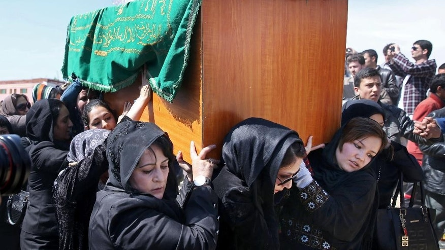 March 22, 2015:  Afghan women rights activists carry the coffin of 27-year-old Farkhunda, an Afghan woman who was beaten to death by a mob, during her funeral, in Kabul.