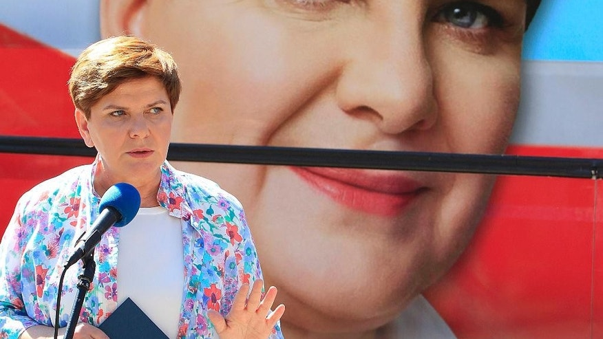 Conservative opposition Law and Justice party candidate for Prime Minister in General Elections later in 2015, Beata Szydlo talks to supporters in Warsaw, Poland, Wednesday, July 1, 2015.  Szydlo successfully managed the recent election campaign to elect Andrzej Duda as President, and now hopes to repeat that success in parliamentary elections to become Poland's new government leader. (AP Photo/Czarek Sokolowski)