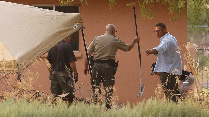 Pinal County investigators dig behind a home in Maricopa, Ariz., looking for clues in the disappearance of Michael and Tina Careccia.