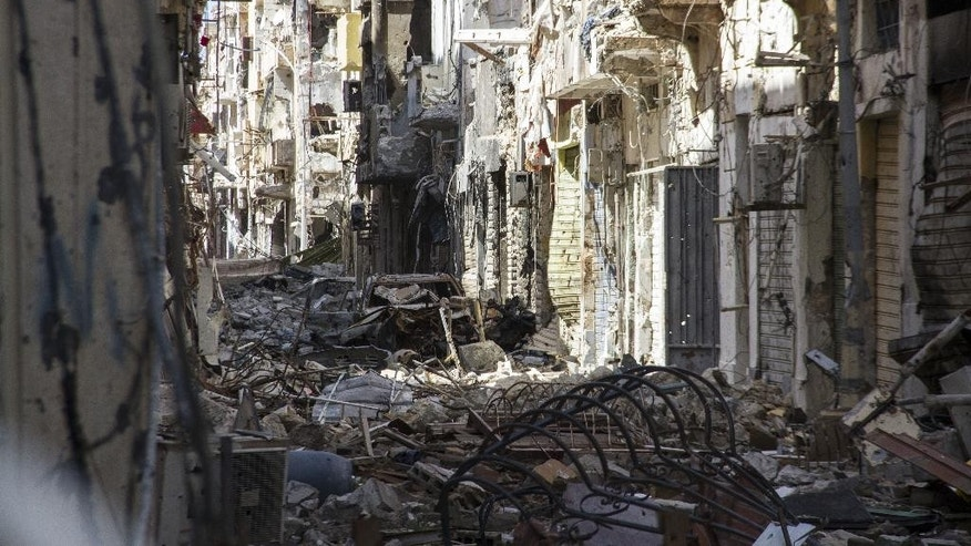 In this photo taken on April 4, 2015, a street is filled with debris and abandoned houses in the city of Benghazi, Libya. Destruction has permeated the North African country since the civil war ousted Moammar Gadhafi four years ago. For Benghazi, the past year was the worst.   (AP Photo/Mohamed Salama)