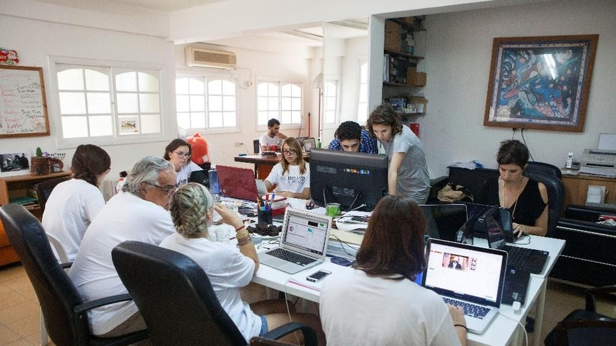 Members of the Yala Young Leaders group, an Internet-based peace movement of Middle Eastern and North African youth, sit at the group's headquarters in Tel Aviv, Israel, Thursday, July 2, 2015. Four years ago, disillusioned former peace negotiator Uri Savir launched a Facebook group aimed at bringing together moderate voices from Israel and across the Arab world. Now he's celebrating his vision with a near million-strong online movement stretching across the Middle East's most hostile borders. (AP Photo/Dan Balilty)
