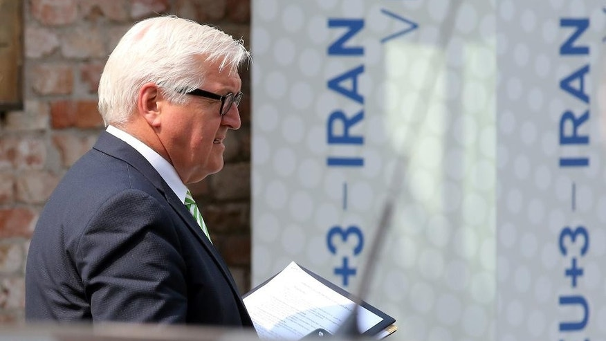 German Foreign Minister Frank-Walter Steinmeier leaves Palais Coburg where closed-door nuclear talks with Iran take place in Vienna, Austria, Thursday, July 2, 2015. (AP Photo/Ronald Zak)