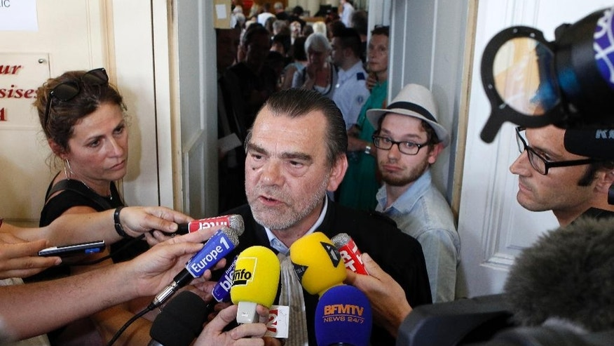 Franck Berton, lawyer of Dominique Cottrez, answers reporters after the verdict in the case, Thursday, July 2, 2015 in Douai, northern France. A Frenchwoman accused of killing eight of her newborns over more than a decade has been sentenced to nine years in prison after a one-week dramatic and teary murder trial. After deliberating a few hours in the northern city of Douai, the jury on Thursday returned its verdict - twice as lenient as the 18-year prison term asked by the prosecutor against Dominique Cottrez, a 51-year-old married mother. The jury decided that her judgment was impaired at the time of the killings.(AP Photo/Michel Spingler)