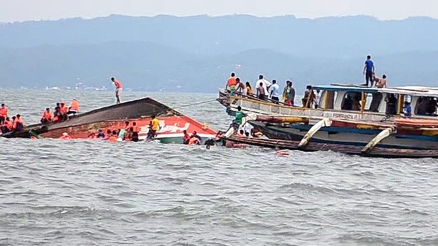 July 2, 2015: The Philippine Coast Guard rescues boat passengers after a ferry boat capsized in choppy waters in Ornoc, Philippines.