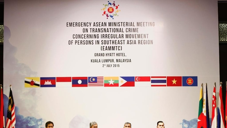 From left to right, Malaysian Home Ministry Secretary General Alwi Haji Ibrahim, Home Affairs Minister Ahmad Zahid Hamidi, Malaysian national police chief Khalid Abu Bakar and Home Affairs Principal Assistant Secretary International Division Abdul Munir Lutfi attend and an emergency ASEAN ministerial meeting on the migrant crisis in Kuala Lumpur, Malaysia, Thursday, July 2, 2015. (AP Photo/Vincent Thian)