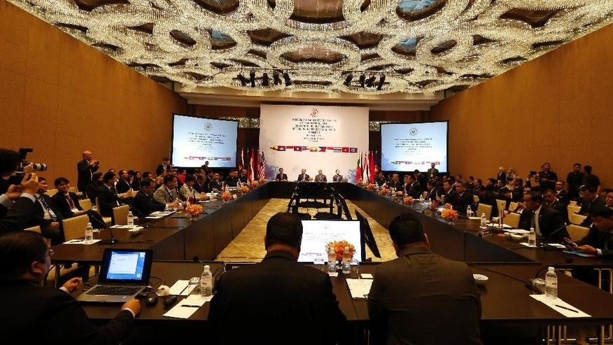 Ministers and representatives from ASEAN countries attend a meeting on the regional migrant crisis in Kuala Lumpur, Malaysia, Thursday, July 2, 2015. (AP Photo/Vincent Thian)