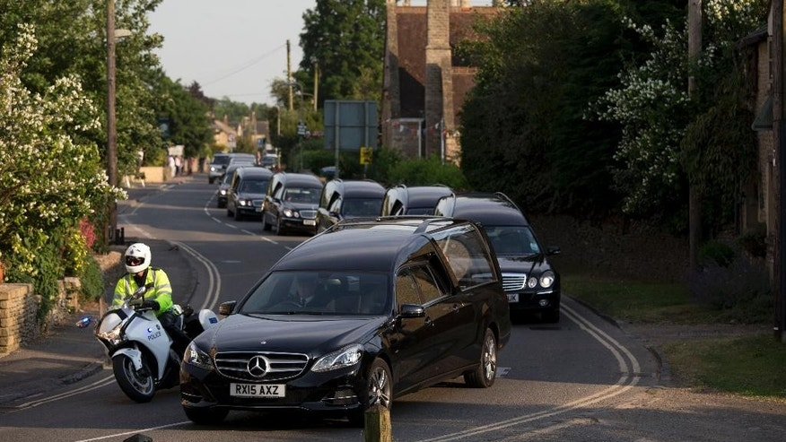 Hearses carry British victims of the Tunisia beach attack after a plane repatriating their remains landed at the RAF (Royal Air Force) Brize Norton base in Brize Norton, England, Wednesday, July 1, 2015.  Britain on Wednesday began repatriating the remains of victims of last week's terror attack at a Tunisian beach resort.  (AP Photo/Matt Dunham)