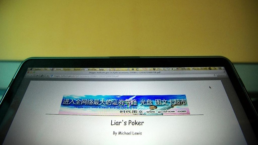 "In this Thursday, June 25, 2015 photo, a pirated copy of the book ""Liar's Poker"" by Michael Lewis, hosted on and loaded from a website run by the Chinese Commerce Ministry, is displayed on a computer screen in Beijing. A complete bootlegged copy of Lewis' bestselling book about Wall Street, ""Liar's Poker,"" was hosted on the official website of the ministry, the agency responsible for intellectual property protection in China, The Associated Press has found. (AP Photo/Mark Schiefelbein)"