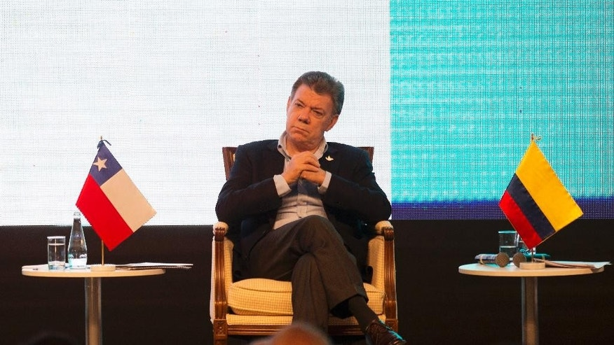 Colombia's President Juan Manuel Santos listens in during the closing ceremony of the Business Summit in Paracas, Peru, Thursday, July 2, 2015. The Business Summit of the Pacific Alliance is taking place on parallel with the 5th Presidential Pacific Alliance Summit which starts on Friday. (AP Photo/Rodrigo Abd)