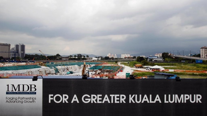 In this May 14, 2015 photo, state investment fund 1 Malaysia Development Berhad's (1MDB) Tun Razak Exchange development site is pictured in Kuala Lumpur, Malaysia. Malaysia's state investment fund 1MDB says it has never provided any funds to Prime Minister Najib Razak, denying reports that entities linked to the fund had funneled $700 million ($2.6 billion) into Najib's personal accounts. (AP Photo/Joshua Paul)