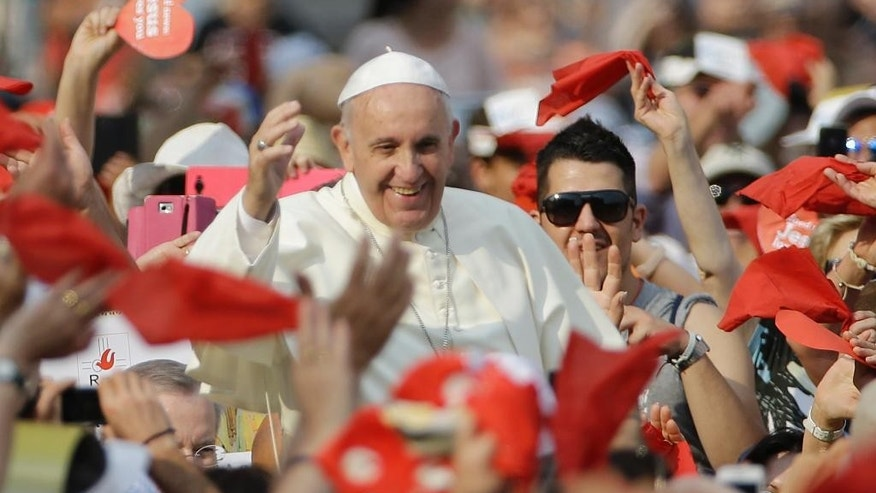 Pope Francis waves as he arrives for a meeting with faithful of the Holy Spirit movement in St. Peter's Square at the Vatican, Friday, July 3, 2015. (AP Photo/Gregorio Borgia)