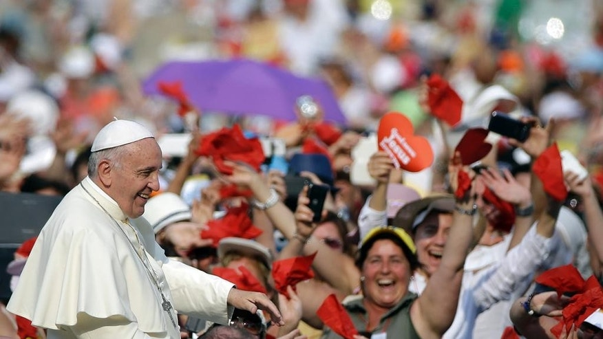 Pope Francis arrives for a meeting with faithful of the Holy Spirit movement in St. Peter's Square at the Vatican, Friday, July 3, 2015. (AP Photo/Gregorio Borgia)