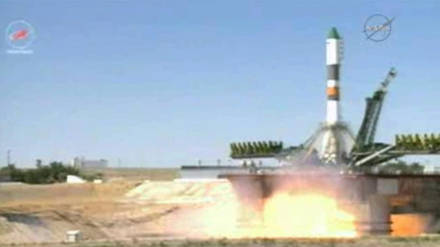 In this image taken from video, a Soyuz-U rocket blasts off at the Russian leased Baikonur cosmodrome, Kazakhstan, Friday, July 3, 2015. The unmanned cargo ship is heading to the International Space Station, whose crew is anxiously awaiting it after the successive failures of two previous supply missions. (NASA TV via AP)