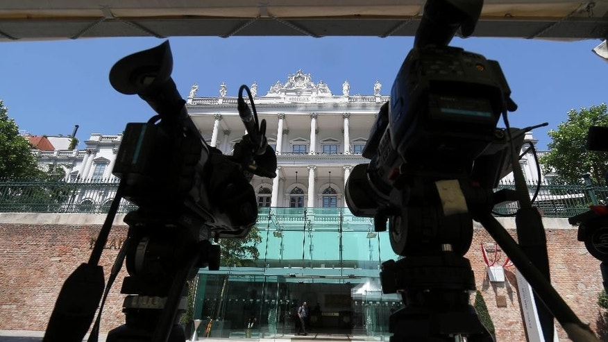 TV cameras stand in front of Palais Coburg where closed-door nuclear talks with Iran take place in Vienna, Austria, Friday, July 3, 2015. (AP Photo/Ronald Zak)