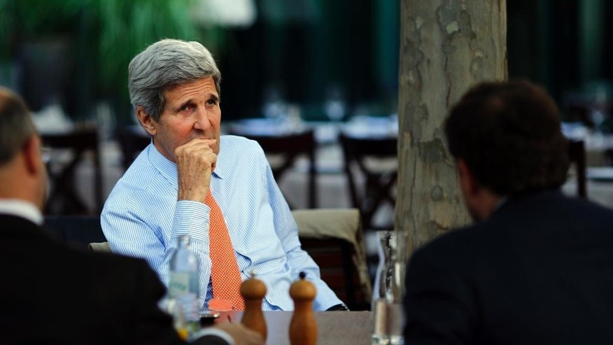 U.S. Secretary of State John Kerry, center, National Security Council point person on the Middle East Robert Malley, left, and Chief of Staff at the U.S. Department of State Jon Finer meet on the terrace of a hotel where the Iran nuclear talks meetings are being held in Vienna, Austria, Thursday, July 2, 2015.  (Carlos Barria/Pool via AP)