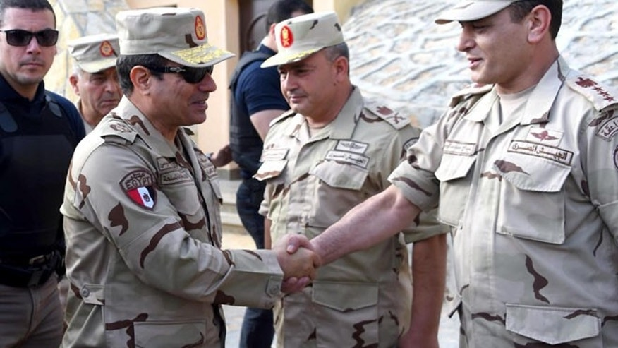 July 4, 2015: In this picture provided by the office of the Egyptian Presidency, Egyptian President Abdel-Fattah el-Sissi, second left, greets members of the Egyptian armed forces in Northern Sinai, Egypt. (AP)