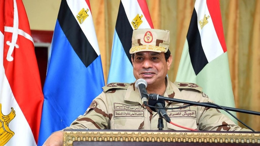 In this picture provided by the office of the Egyptian Presidency, Egyptian President Abdel-Fattah el-Sissi addresses members of the Egyptian armed forces in Northern Sinai, Egypt, Saturday, July 4, 2015.  Egyptian President Abdel-Fattah el-Sissi has travelled to the troubled northern part of the Sinai Peninsula to inspect troops, after Islamic State-linked militants struck a deadly blow against the military this week in a coordinated assault. (Egyptian Presidency /Mohammed Abdel-Muati via AP)