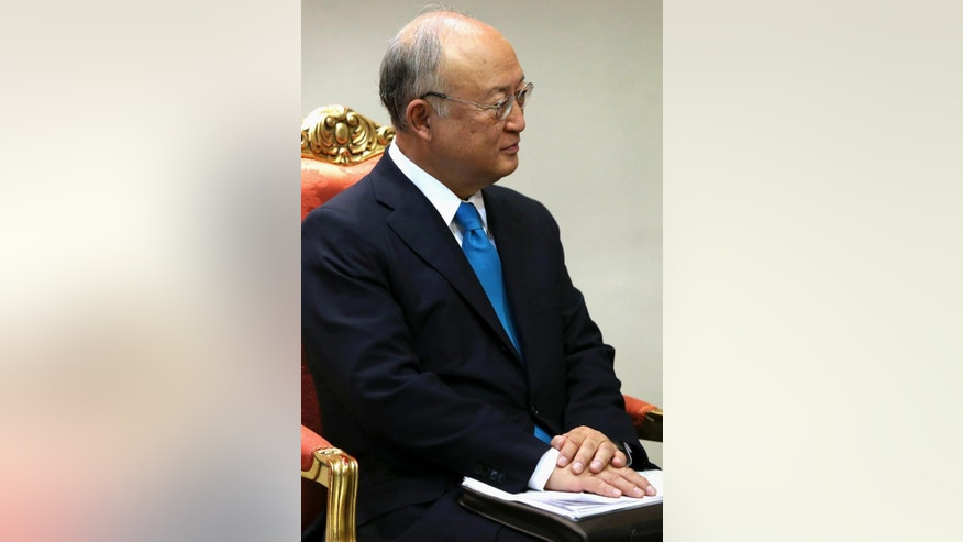 The International Atomic Energy Agency's director-general, Yukiya Amano, is seated during his meeting with Iran's President Hassan Rouhani in Tehran, Iran, Thursday, July 2, 2015. The head of the U.N. atomic agency, Amano, visited Tehran to discuss remaining outstanding issues over Iran's nuclear program. (AP Photo/Ebrahim Noroozi)