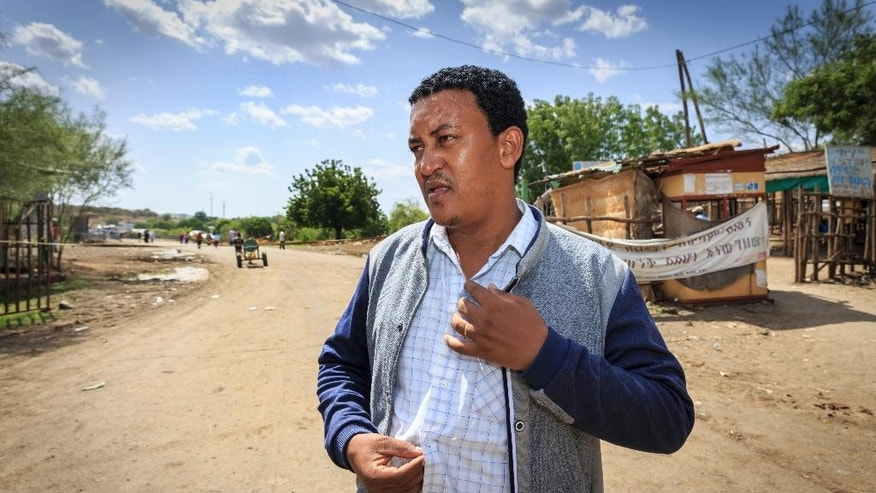 In this photo taken Wednesday, June 3, 2015, Town Mayor Teshome Agmas speaks to The Associated Press in Metema, in northwestern Ethiopia next to the border with Sudan. The town is a center for a booming trade in migrants from Ethiopia, Eritrea, Somalia and Sudan, with many hoping to make their way to Europe, but life here is now a cat-and-mouse game: The authorities are cracking down, yet the migrants just keep coming, often risking death. (AP Photo/Mulugeta Ayene)