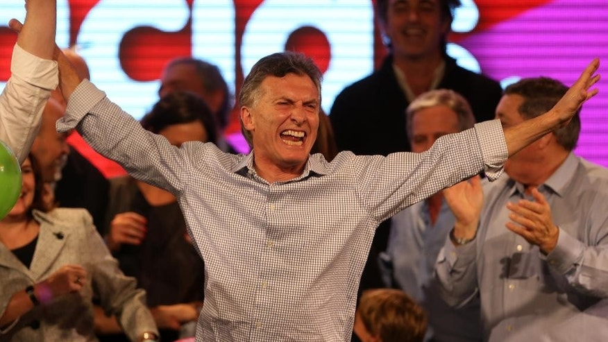 Surrounded by supporters, the current Mayor of Buenos Aires and presidential candidate Mauricio Macri celebrates at the end of mayoral elections in Buenos Aires, Argentina, Sunday, July 5, 2015. Buenos Aires will have a runoff election that would have the current Cabinet Chief of Buenos Aires and mayoral candidate Horacio Rodriguez Larreta competing against Martín Lousteau, candidate of the ECO coalition. (AP Photo/Daniel Jayo)